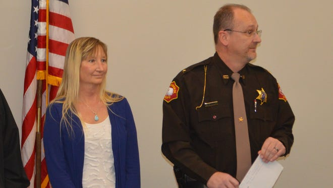 Sharon Zielke, who was saved by emergency dispatchers through a new system, and Sheboygan County Sheriff Cory Roeseler speak at a meet and greet at the Sheboygan County Sheriff's Office on March 6 celebrating the success.