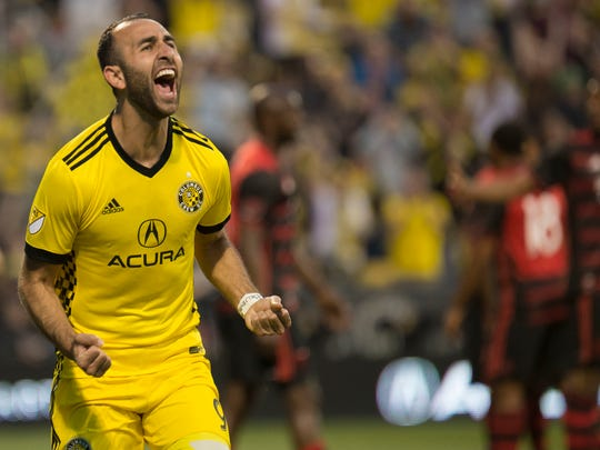Columbus Crew forward Justin Meram celebrates following a goal against the Portland Timbers during the first half of an MLS soccer match, Saturday, March 25, 2017, in Columbus, Ohio. (AP Photo/Bryan Woolston)