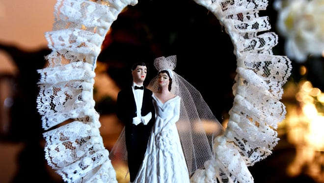 This file photo shows a wedding cake topper.