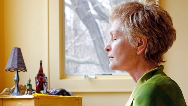 Debra Richardson, 58, was diagnosed with thyroid cancer in 2005 and had surgery to remove her thyroid. She'd always taken good care of herself with annual cleanses and yoga. After her diagnosis she depend her yoga practice and took up mediation in order to reduce stress and anxiety. Richardson is photographed in her meditating room at home in Upper Grandview.