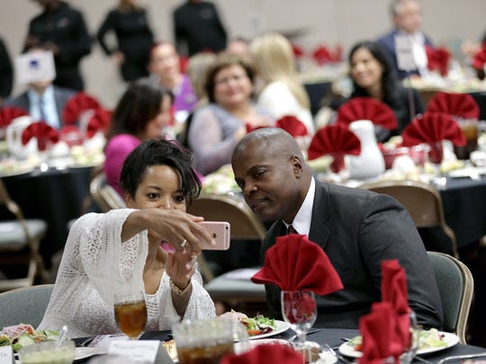Karen Wilson Twitty takes a selfie with her husband Maj. Gen. Stephen Twitty, Commander of Fort Bliss, during the State of the City address Wednesday.