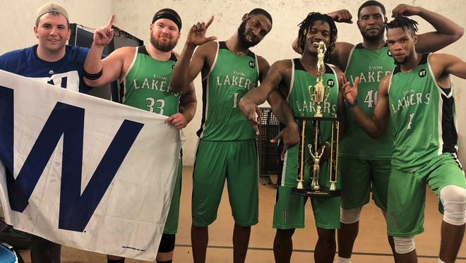 The Mountain Home Twin Lakers celebrate after winning the Battleground Basketball Association championship in Greenville, Miss.
