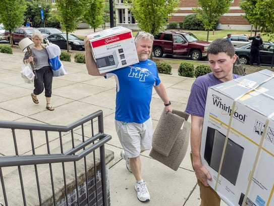Caleb Watts, right, an MTSU freshman, moves into Corlew