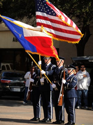 The Dyess Air Force Base honor guard posts the colors for the national anthem during the 2016 Veterans Day parade in downtown Abilene.