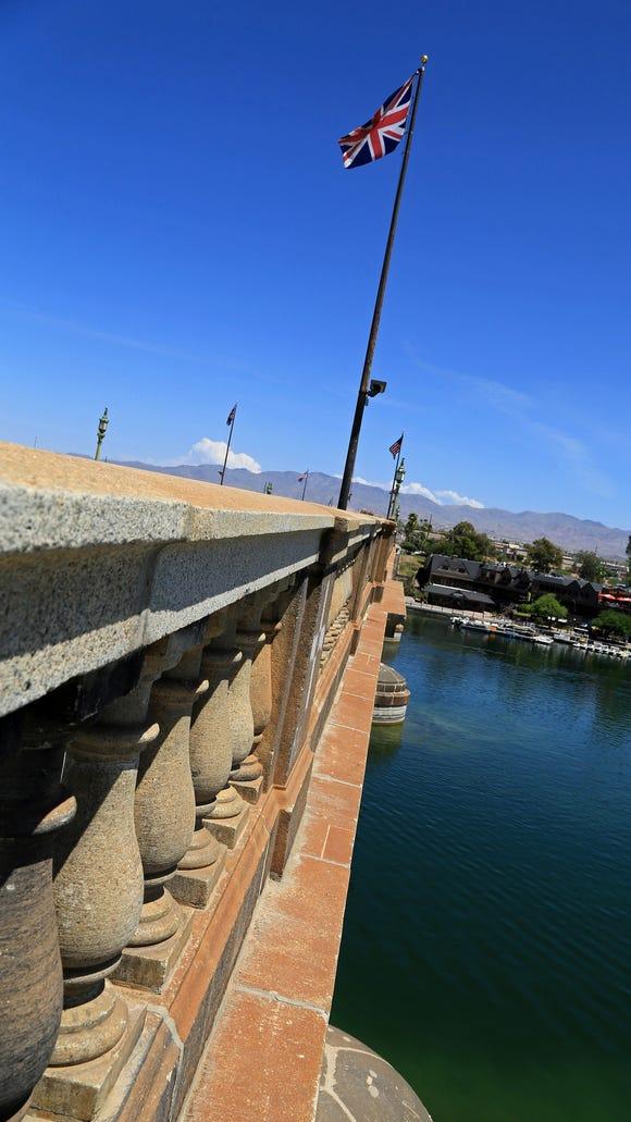 London Bridge crosses the green waters of Bridgewater Channel in Lake Havasu City, Arizona.