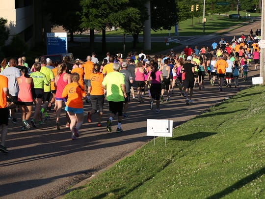 2 Runners and walkers stream down West Forrest Ave Thursday eve.JPG