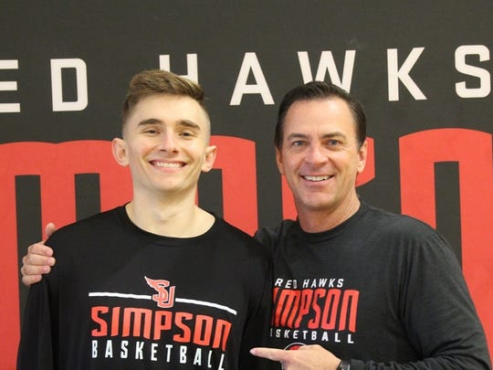 Foothill High School grad and Shasta College transfer Blake Trent, left, poses with Simpson University head men's basketball coach Todd Franklin. Simpson recently signed Trent to play for the Red Hawks next season.
