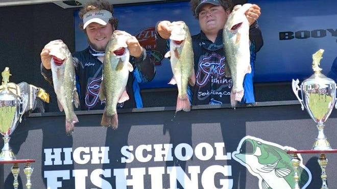 Members of high school bass fishing clubs can qualify for state and even national tournaments. In this photo Peyton Porter and Coleman Jennings, a team from a Kentucky high school, show part of their winning catch at the 2015 High School Fishing World Finals.