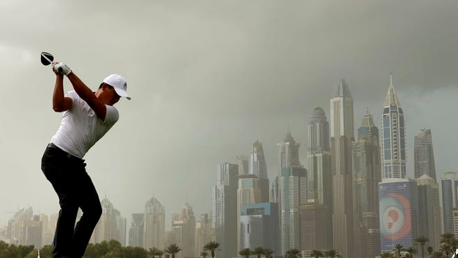 China's Ashun Wu tees off on the 8th hole during the final round of the Dubai Desert Classic golf tournament in Dubai, United Arab Emirates, Sunday, Jan. 26, 2020.