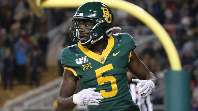 Baylor wide receiver Denzel Mims (5) looks over to the side line after a touchdown in an NCAA college football game against West Virginia in Waco, Texas, Thursday, Oct. 31, 2019.