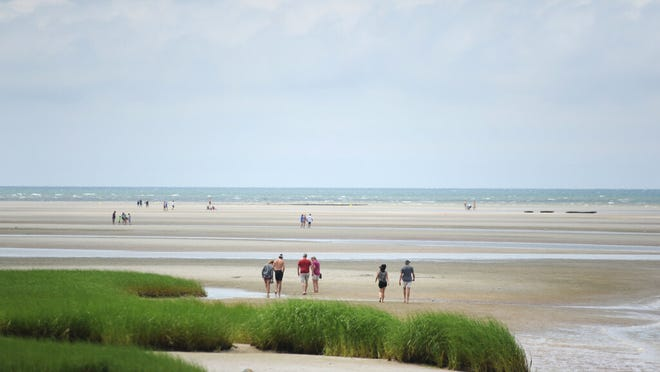 Sun's out, tide's out at Rock Harbor Tuesday afternoon.