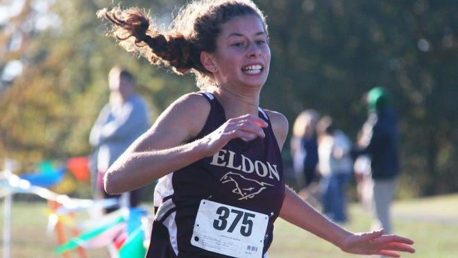 Eldon freshman Zoe Martonfi races towards the finish line in the Tri-County Conference meet at Eldon Country Club on Thursday, October 15. Martonfi finished second amongst a field of 36 runners to earn All-Conference honors.