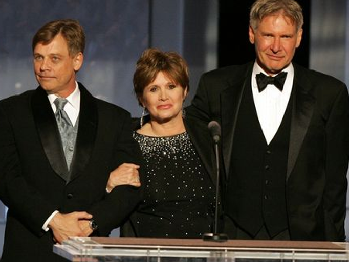 From left, Mark Hamill, Carrie Fisher and Harrison