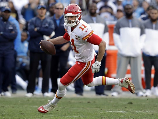 Kansas City Chiefs quarterback Alex Smith (11) runs