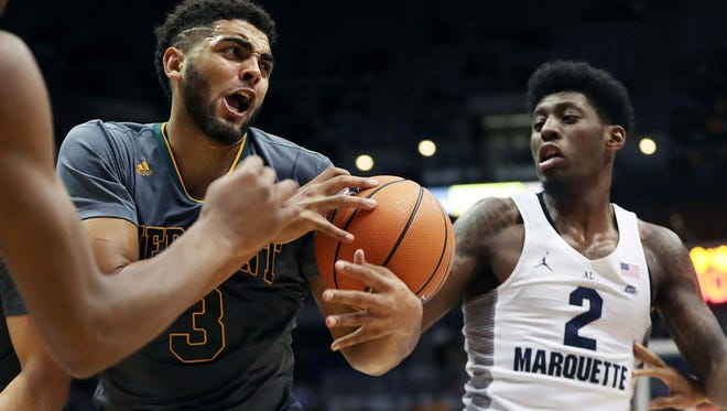 Vermont Catamounts forward Anthony Lamb (3) fights with Marquette Golden Eagles guard Sacar Anim (2) over a loose ball during Marquette's  91-81 win over Vermont  in the men's basketball game at the BMO Harris Bradley Center in Milwaukee, Wisconsin, Tuesday, December 05, 2017.  Milwaukee Journal Sentinel photo by Rick Wood/RWOOD@JOURNALSENTINEL.COM