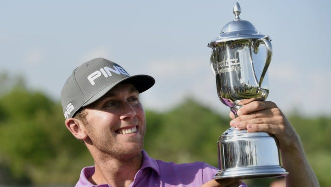 Seamus Power is all smiles as he is handed the United Leasing & Finance Championship trophy at Victoria National Golf Club in Newburgh on May1, 2016. Power finished with a 67 while winning the title.