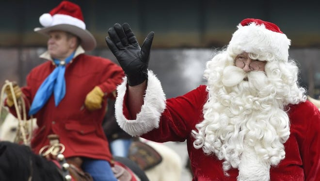 Santa makes his appearance at Saturday's Henderson Shrine Club Merchants Annual Christmas Parade in 2014.