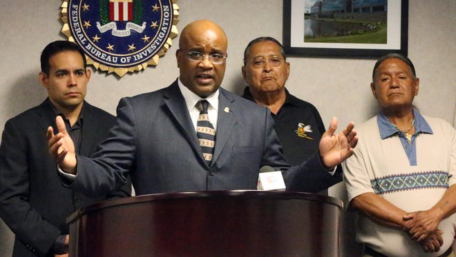 Emmerson Buie Jr., center, special agent in charge of the FBI El Paso Field Office, on Friday announces that the agency's Civil Rights Division and the U.S. Attorney's Office for the Western District of Texas have opened an investigation into the vandalism of a sculpture of an Ysleta del Sur Pueblo woman on Columbus Day on tribal land at the Tigua Indian Cultural Center at 305 Yaya Lane. He was joined by tribal leaders. They are, from left, Lt. Gov. Chris Gomez, Cacique Joe Sierra Jr. and War Captain Javier Loera. Buie also announced a reward for information leading to the arrest of whoever vandalized the statue depicting Nestora Granillo Piarote, a Tigua woman who died in 1918. The FBI is offering a $6,000 reward while the Ysleta del Sur Pueblo is offering another $2,000. The Sociedad Cultural de España also has offered $2,000, bringing the total reward amount to $10,000. The FBI has jurisdiction to investigate both hate crimes and crimes occurring on tribal lands, an FBI news release states. The FBI asks anyone with information to call 832-5000 or share tips online at tips.fbi.gov.