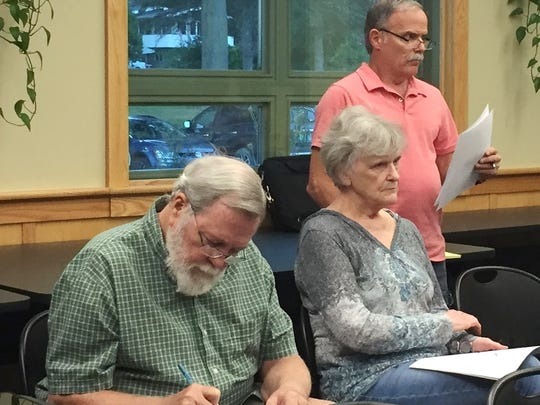 John and Ramona Sheppard, left, listen as Dennis Bergeron reads a statement Thursday night at a meeting of the Recreation Governance Study Committee at the Essex Police Department. Photographed on Thursday, Sept. 1, 2016.