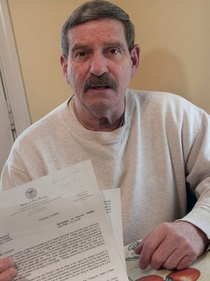 Richard Pfieffer shows the $25,347 bill from Medicaid for home-based medical care his mother received before her death at age 92. The repayment is allowed as part of Medicaid estate recovery.