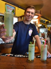 One of Island Fever's specialty drinks is the mojito with fresh muddled mint, lime juice, rum and slowly shakened by Hunter Bjarnarson.