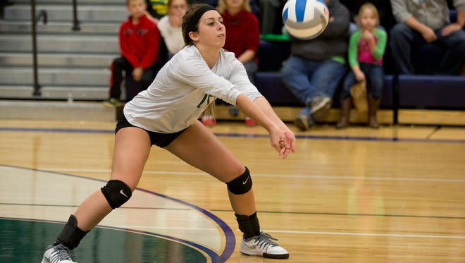 Brown City junior Jasmin Bender digs the ball during a Class C quarterfinal volleyball game Tuesday, November 17, 2015 at Lapeer High School.