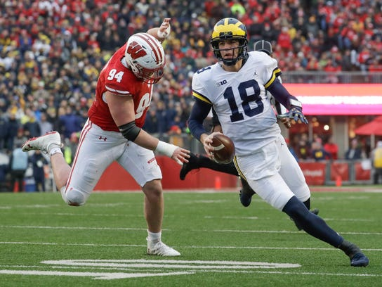 Brandon Peters runs past Wisconsin's Chris Orr during the first half.
