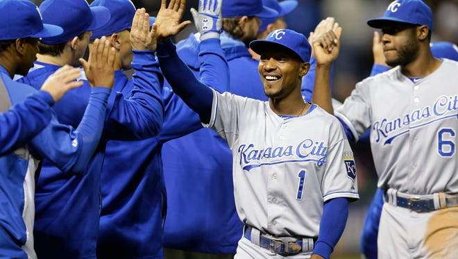 Kansas City Royals' Jarrod Dyson (1) celebrates with teammates after the Royals defeated the Cleveland Indians 2-0 in a baseball game, Monday, Sept. 22, 2014, in Cleveland.