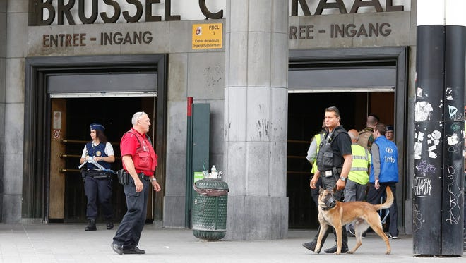 In this photo from June, 2016,  police guard Brussels central station after it was evacuated for security reasons. Police have shown a heightened sense of security since a March terrorist attack in Brussels killed 32 people.