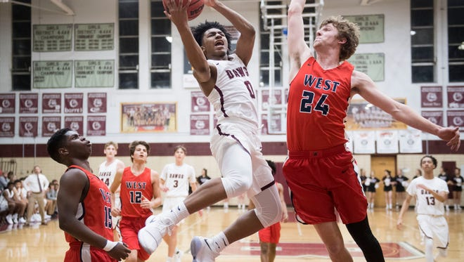 Bearden's Ques Glover attempts to score while defended by West's Charles Dupree on Tuesday, January 9, 2018.