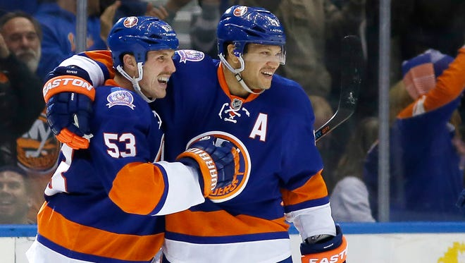 Islanders right wing Kyle Okposo, right, celebrates with center Casey Cizikas, who scored a goal against Tampa Bay  during the third period Tuesday.