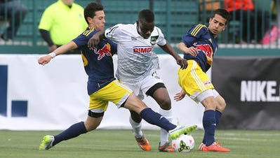 Kenardo Forbes (middle), a new Rhinos midfielder from Jamaica, has been a key component facilitating an attack that has helped fuel Rochester's 5-0-2 start.