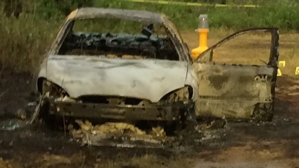 Car found burned down dirt road off Waldron Terrace in Sloatsburg, June 21, 2016. The body of Ossen Lavaud, 48, of Middletown, New York, was found next to the car.