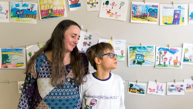 Shannon Feilland with her son Soren at his 13th birthday celebration on Sunday, January 14, 2018. Shannon explained that drawing has become away for Soren to communicate with those around him and that his subjects have a way of working themselves into his limited vocabulary.