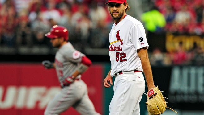 Cardinals starting pitcher Michael Wacha looks on after giving up a solo home run to Reds first baseman Joey Votto during the first inning Friday at Busch Stadium.