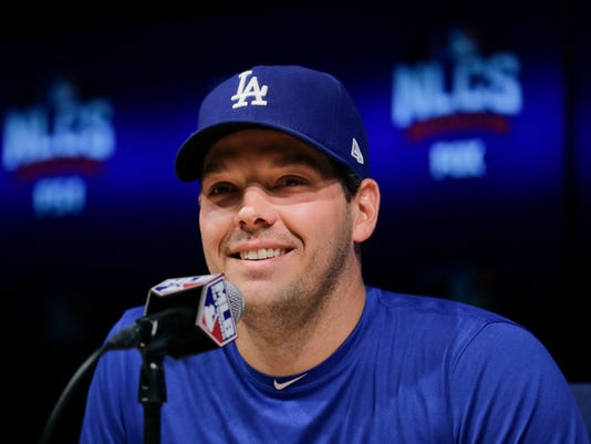 Los Angeles Dodgers starting pitcher Rich Hill smiles while talking to reporters during a news conference ahead of Tuesday's Game 3 of the National League baseball championship series against the Chicago Cubs, Monday, Oct. 17, 2016, in Los Angeles. (AP Photo/Jae C. Hong)