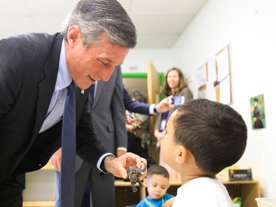 Governor Carney plays with 3-year-old Yassiel Rosa