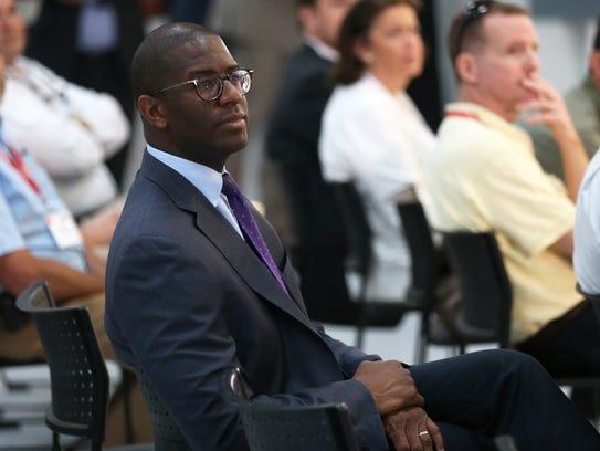 Mayor Andrew Gillum listens to a presentation at Danfoss