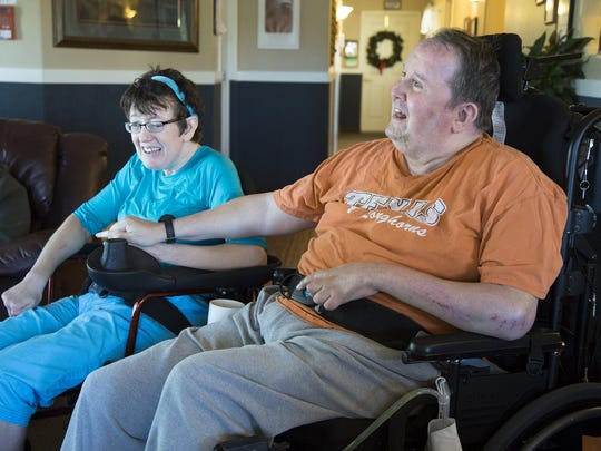 Suanne Odegard, left, and Chris Northcutt sit in the living room in their residence at BeeHive Homes on May 26. Odegard and Northcutt both participate in the swim therapy program provided by Beehive Homes