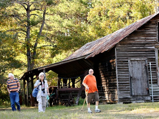 Guests stroll the grounds at Birdsong Nature Center, which is having its 12 Old-Timey Plant Sale on Saturday.