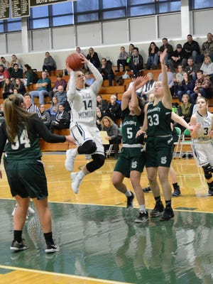 Rice's Lisa Sulejmani rises for a field-goal attempt in the paint during Saturday's game vs. St. Johnsbury. Sulejmani reached 1,000 career points in the Rice win.