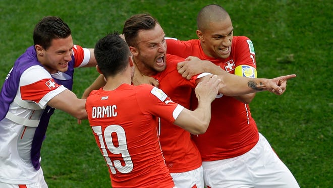 Switzerland's Haris Seferovic, second from right, celebrates scoring his side's second goal with teammates during the group E World Cup soccer match between Switzerland and Ecuador at the Estadio Nacional in Brasilia on Sunday.
