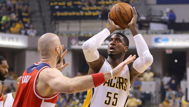 Pacers center Roy Hibbert puts up the first shot of the game, hitting the two-point basket. Indiana Pacers play the Washington Wizards in game 2 of the Eastern Conference Semifinals Wednesday, May 7, 2014, at Bankers Life Fieldhouse.