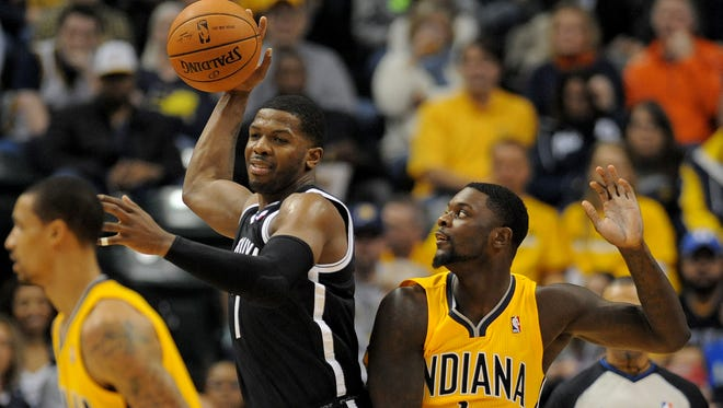 Indiana Pacers guard Lance Stephenson is called for a foul on Brooklyn Nets guard Joe Johnson inside Bankers Life Fieldhouse, Saturday, February 1, 2014, in Indianapolis.