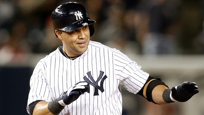 The Yankees' Carlos Beltran is in a dilemma over his elbow. He will have a cortisone injection and see if he can continue to play.