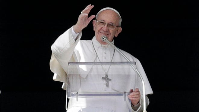 Pope Francis waves to the faithful during the Angelus prayer delivered in St. Peter's Square at the Vatican  March 5.