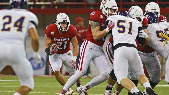 USD's Trevor Bouma (21), here carrying the ball against Western Illinois, is a senior who sat out the last two games with SDSU with injuries.