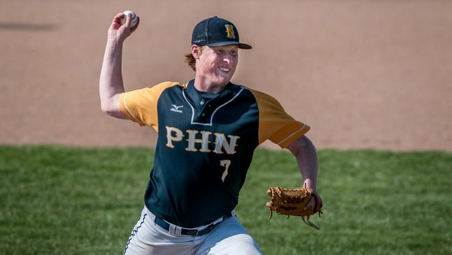 Port Huron Northern's Nick Trimble throws a pitch during a baseball game Wednesday, April 26, 2017 at Port Huron Northern High School.
