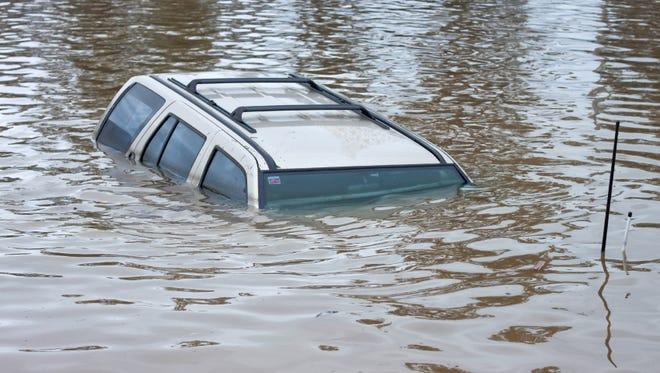 Car swamped in flood water.