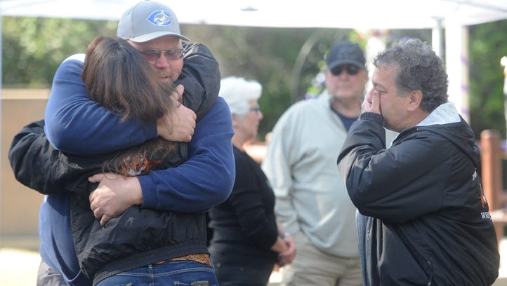 Matthew Hickman Sr. gets hugged by Angela Archibeque during a celebration of life for his son, Matt Hickman Jr., at Oak Grove County Park. Hickman Jr., who was the best wrestler in county history, was killed this month in an accident. At right is Archibeque's husband Bob Archibeque.